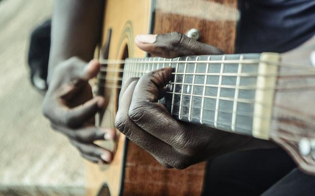 brown dreadnought acoustic guitar